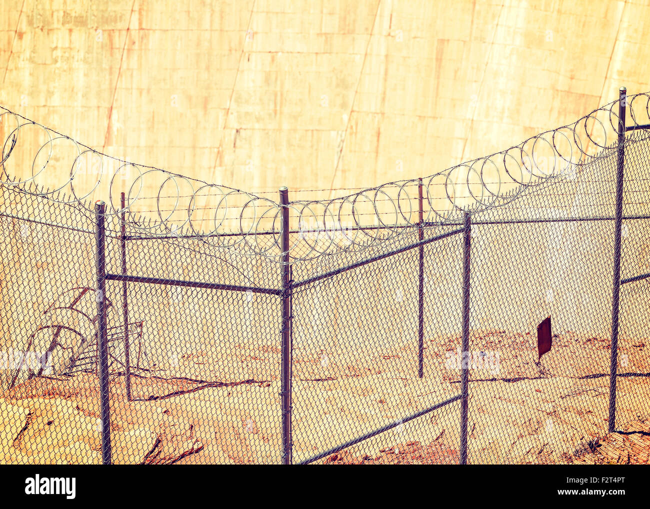 Barbed wire fence, shallow depth of field, crime and punishment concept photo. - Stock Image