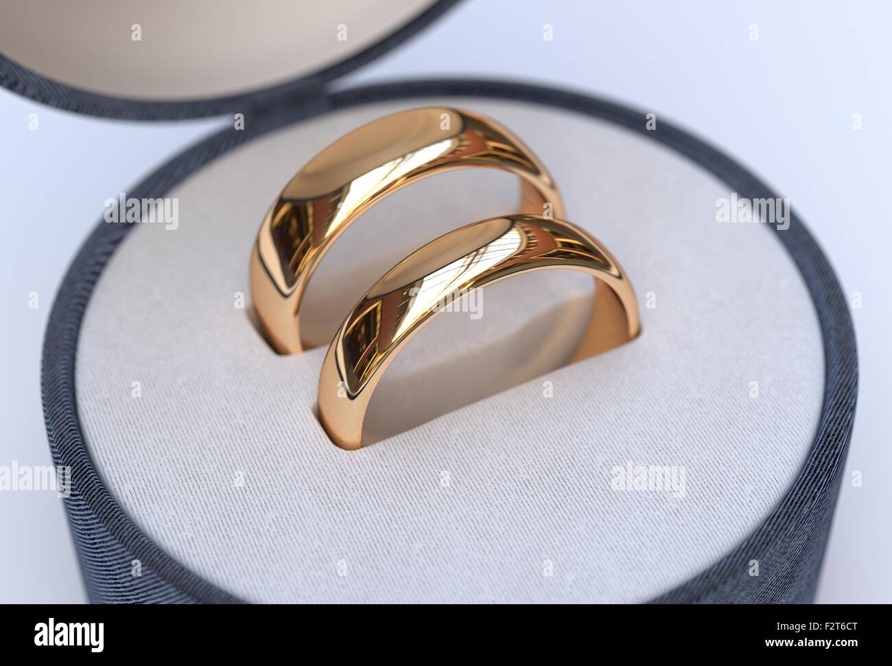 Luxury Couple of gold wedding rings in blue box on white ...