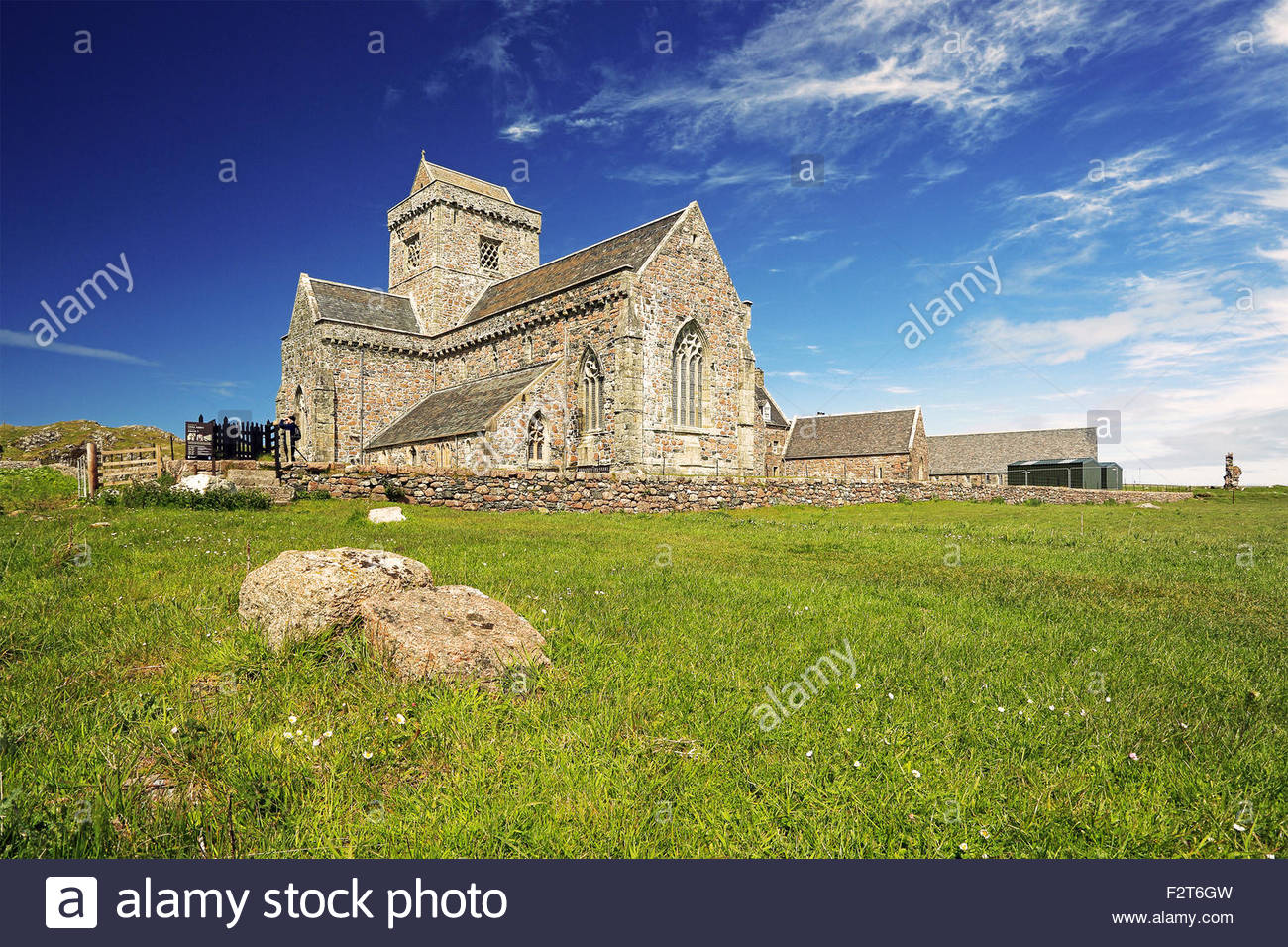 Iona abbey from the isle of Iona on a sunny day. - Stock Image