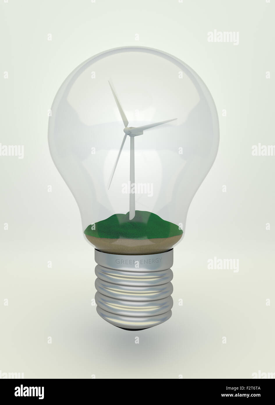 wind turbine on the grass inside light bulb eco light bulb stock