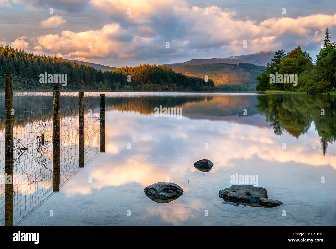 Sunrise on Loch Ard i the Scottish Highlands with Ben Lomond in the distance - Stock Image