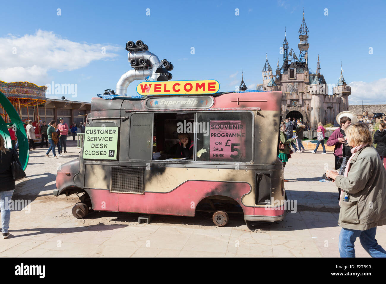 Dismaland : Bemusement Park. Weston-super-Mare. A burnt out ice cream van welcomes visitors. - Stock Image