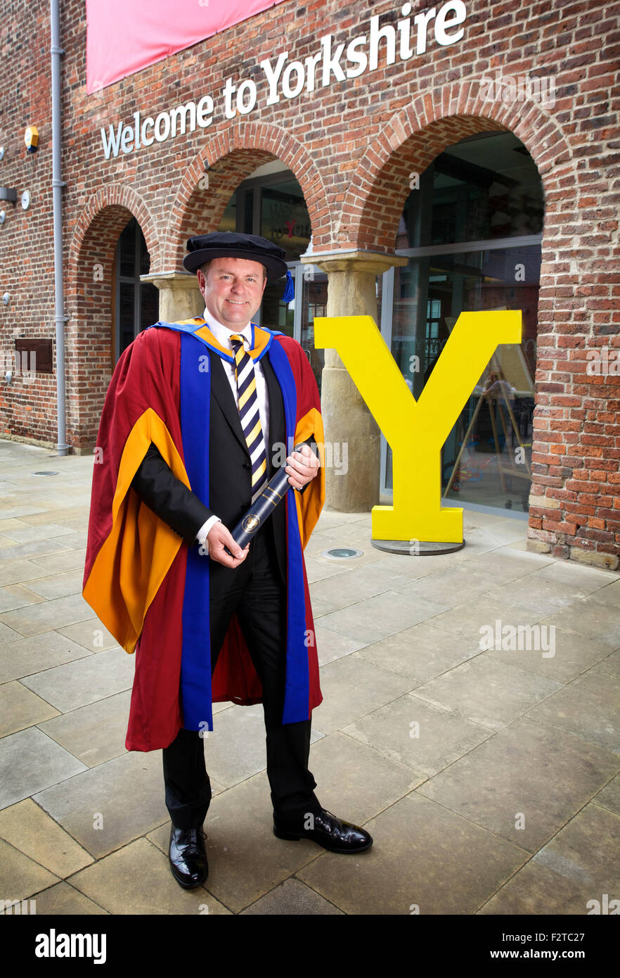 Sir Gary Verity with his Honorary Doctorate in Business Administration from Leeds Beckett University - Stock Image