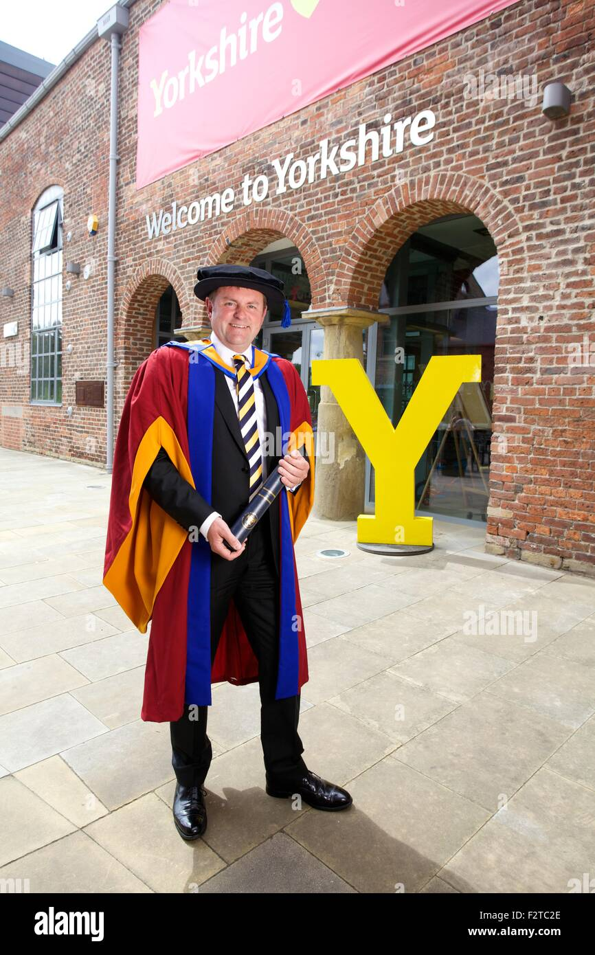 Sir Gary Verity with his Honorary Doctorate in Business Administration from Leeds Beckett University Stock Photo