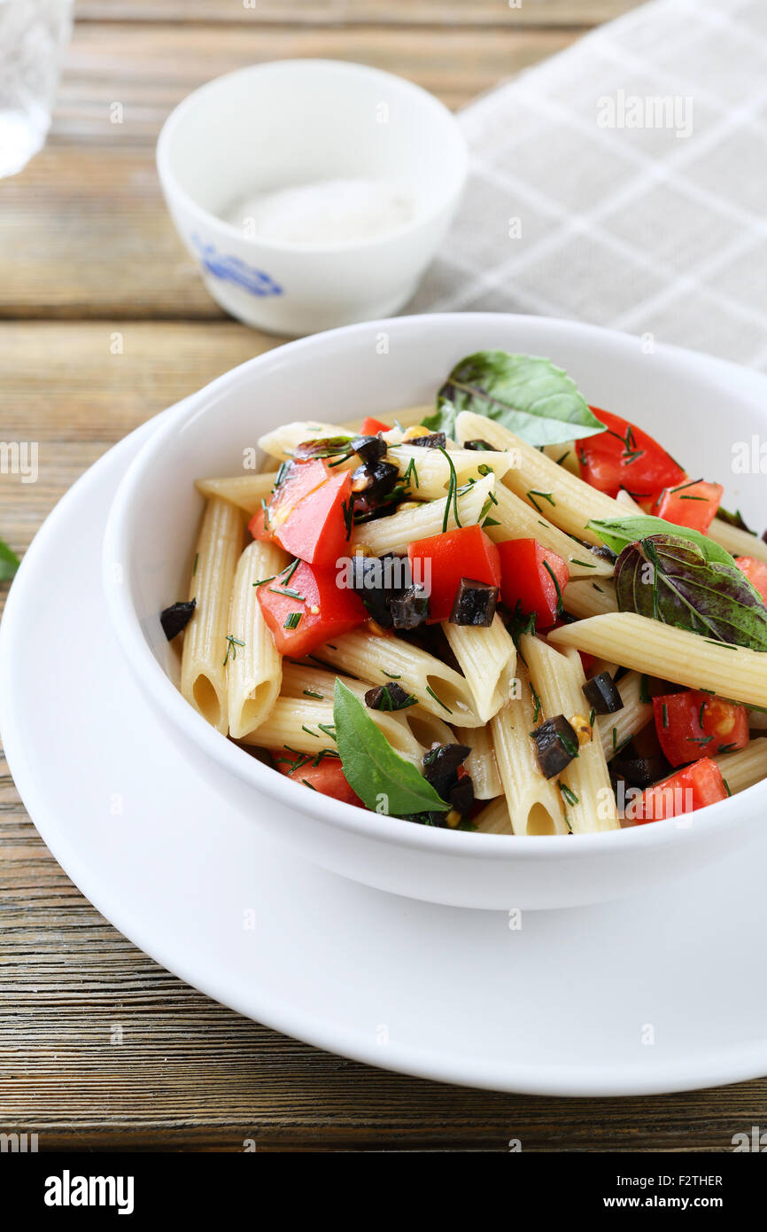 penne with tomatoes and olive, food closeup - Stock Image
