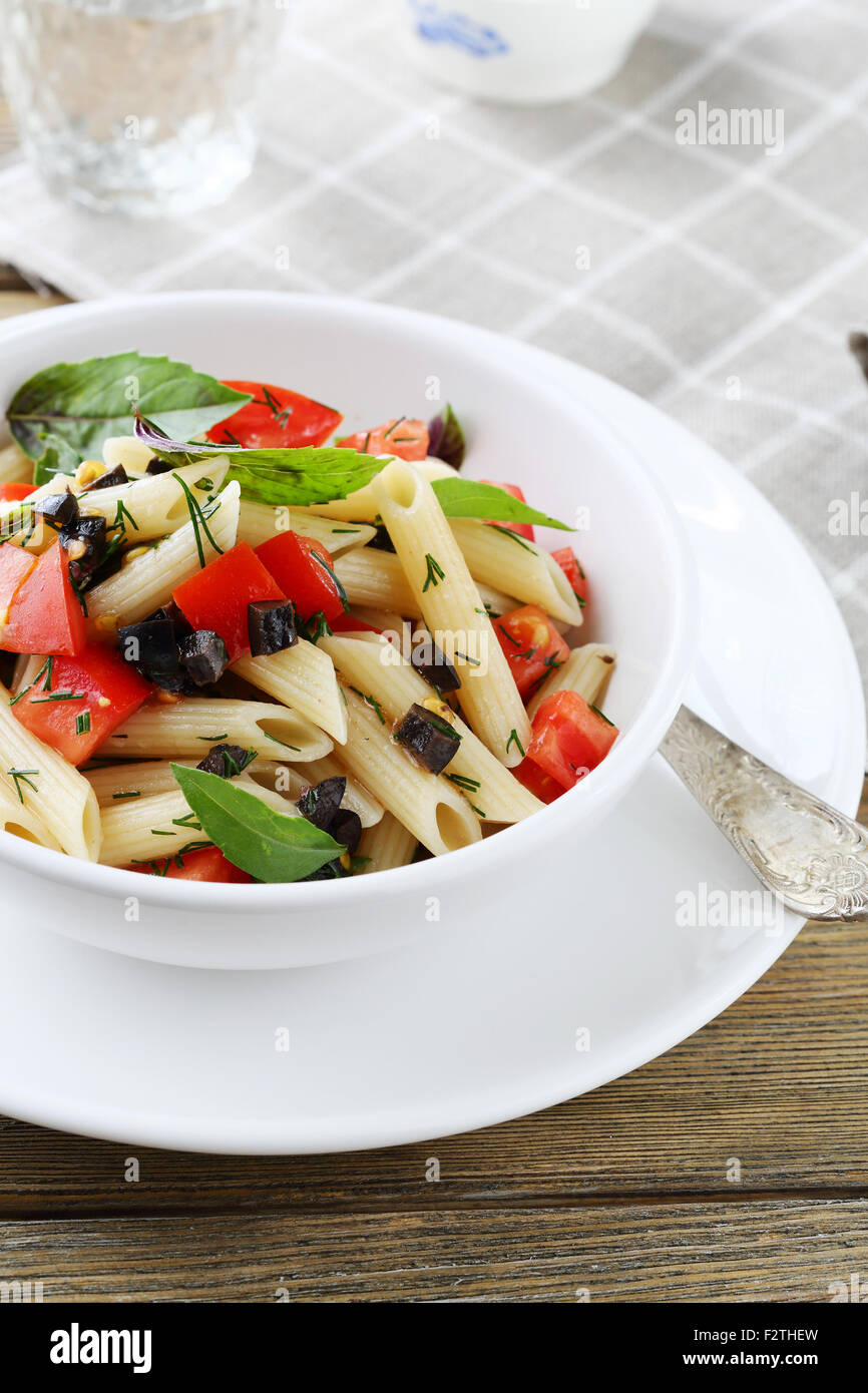 pasta with tomatoes and olive slice, food - Stock Image