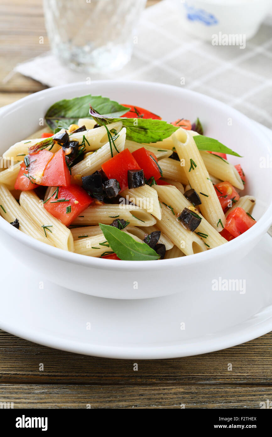 pasta with slice of tomatoes closeup - Stock Image