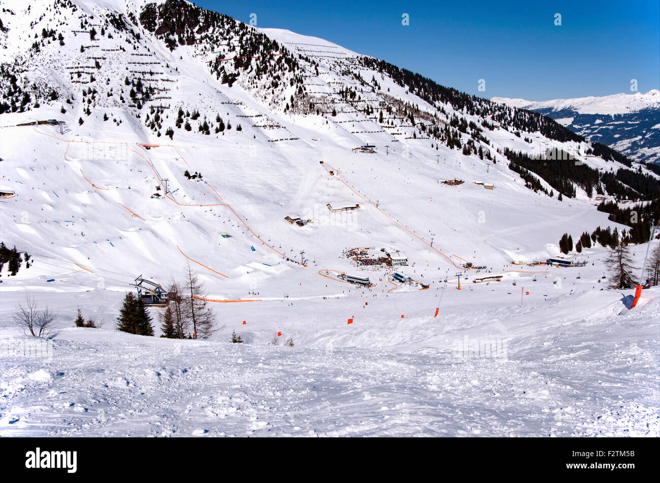 Mayrhofen Ski resort midle station area with ski lifts, pistes and skiers. Zillertal Alps, Tirol, Austria. - Stock Image