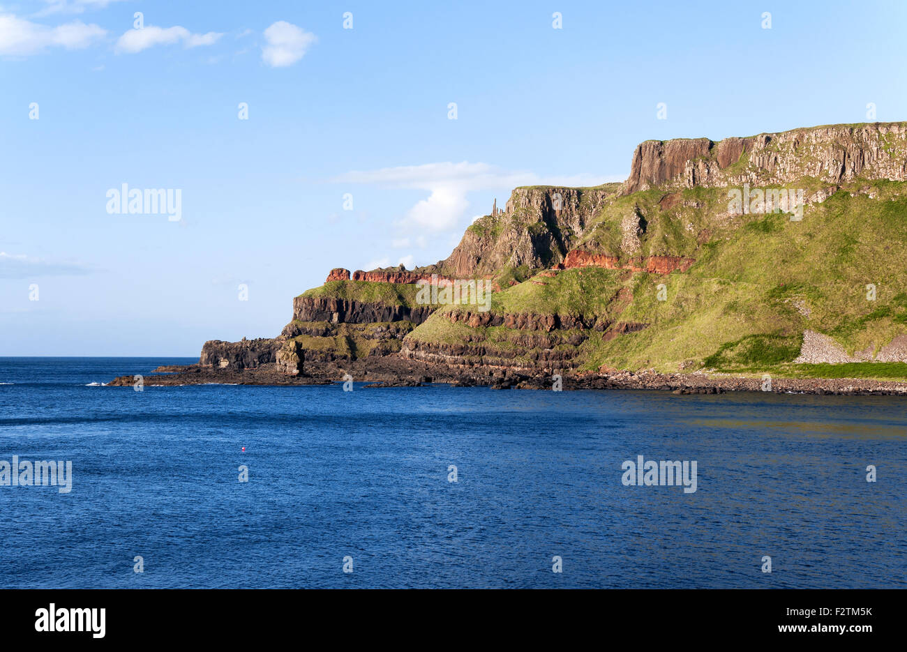 Cliffs near Giants Causeway in Northern Ireland. Unique geological formation - Stock Image