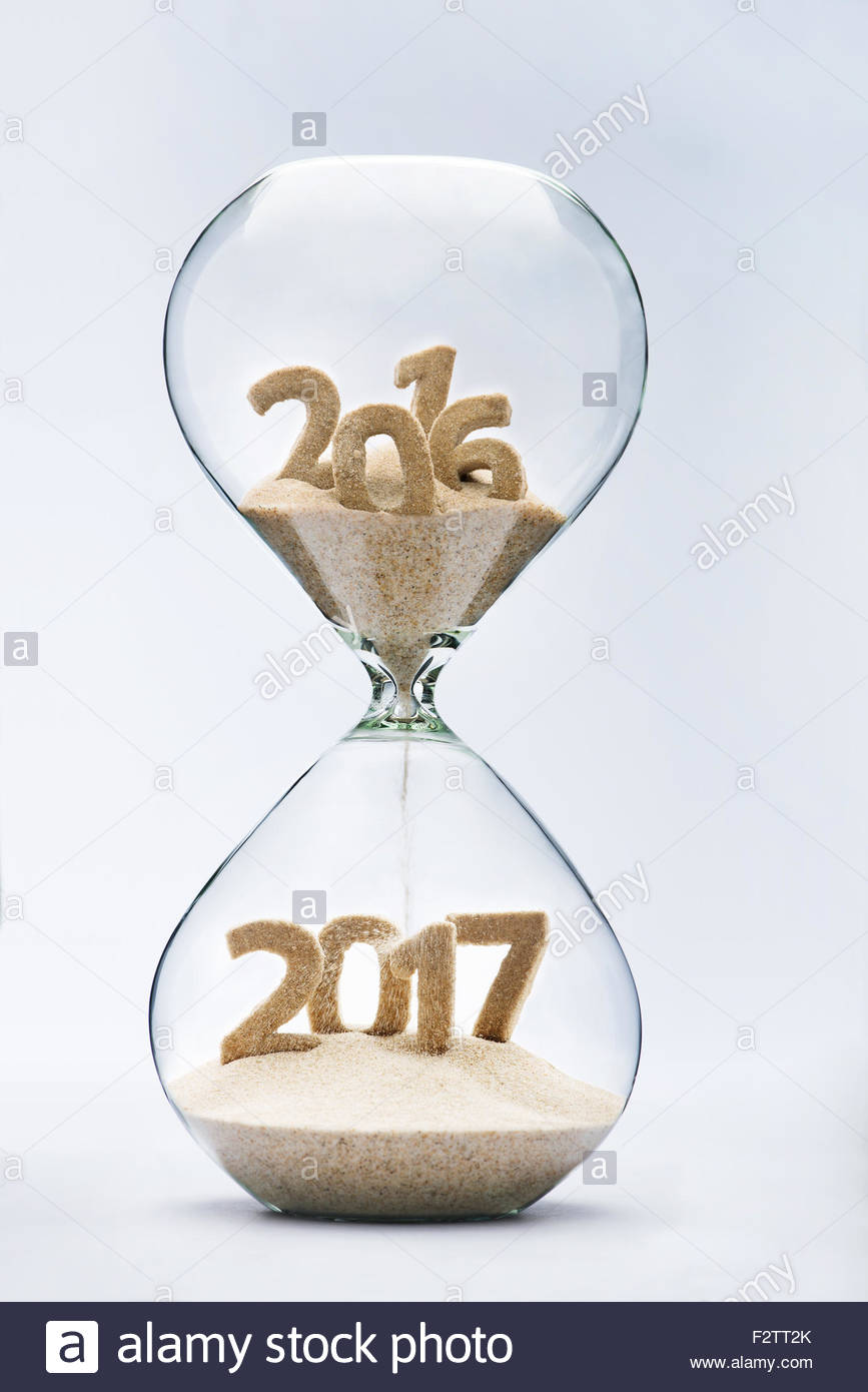 New Year 2016 concept with hourglass falling sand taking the shape of a 2017 - Stock Image