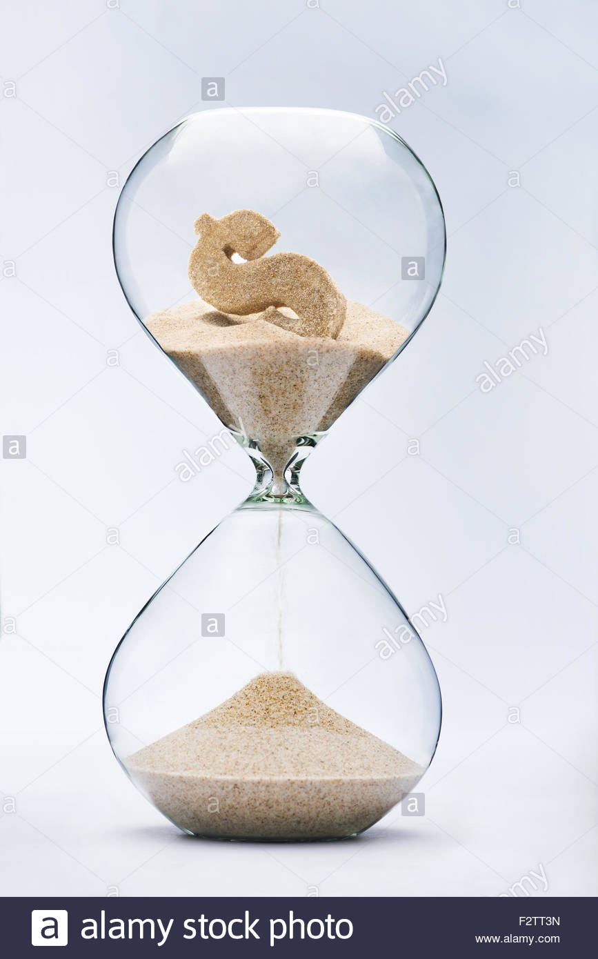 Time is money. Dollar sign flowing down in the hourglass. - Stock Image