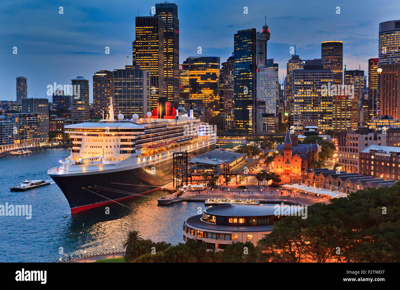 huge transatlantic cruise ship docked new overseas passenger terminal in Sydney Harbour at Sunrise - Stock Image