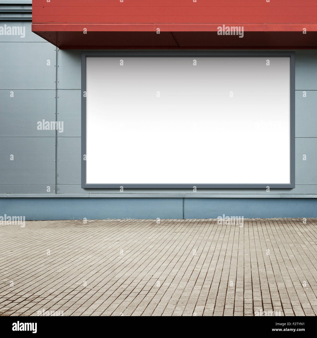 Blank advertising billboard on a street wall. - Stock Image