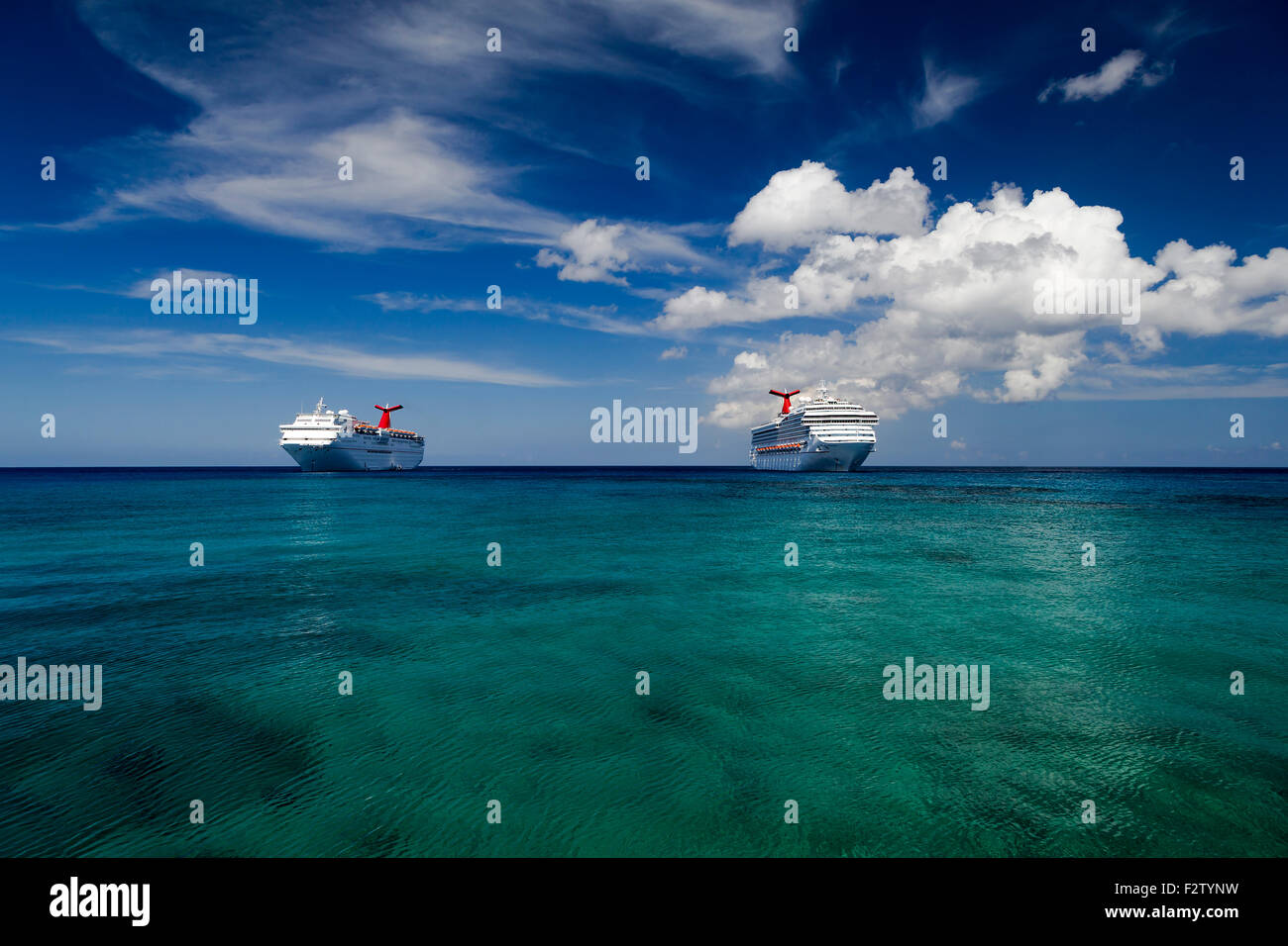 Two carnival cruise ships in the cayman islands - Stock Image