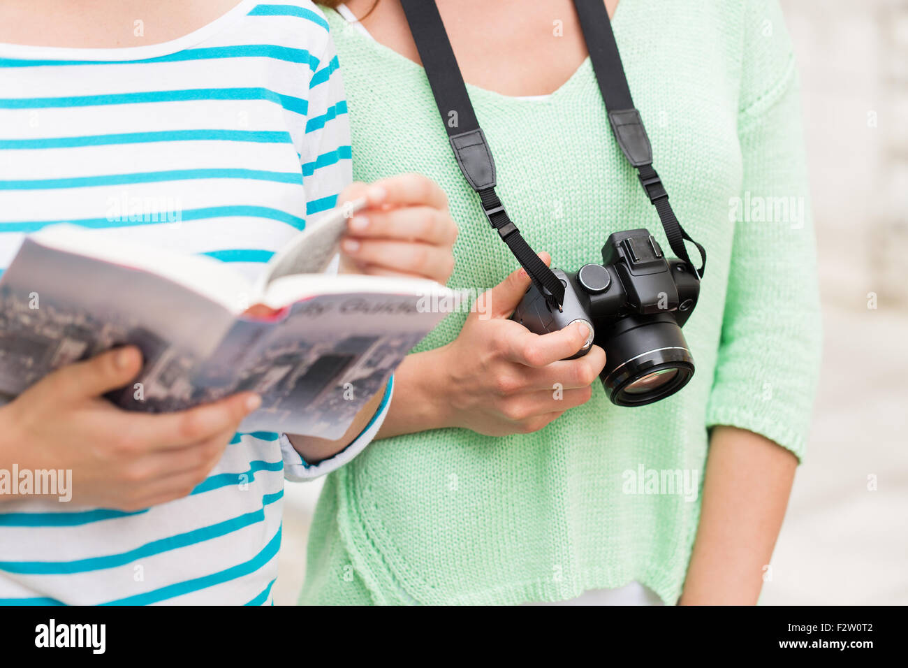 close up of women with city guide and camera - Stock Image