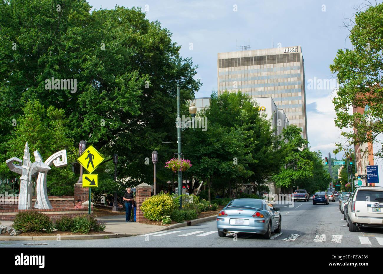 Asheville North Carolina traffic on Patton Avenue downtown at Pritchard Park - Stock Image