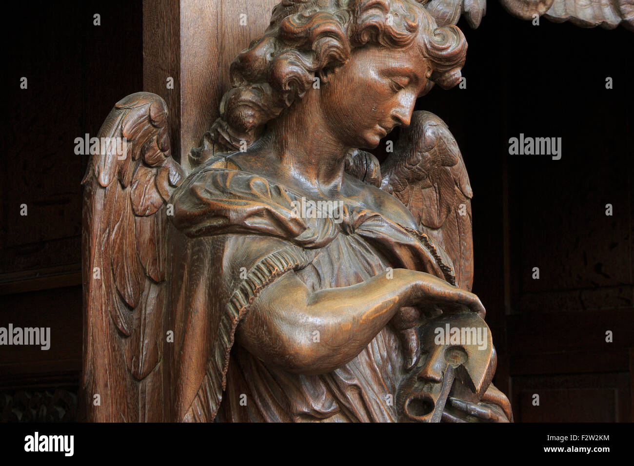 0d06449ea9616 Wood carved statue of an angel at the Saint Peter and Saint Paul Church in  Mechelen