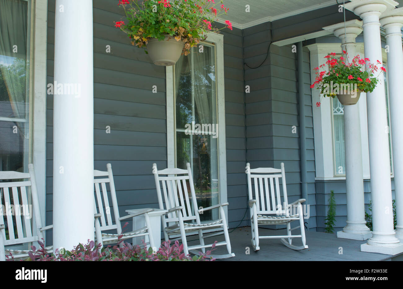 Natchitoches Louisiana porch with rocking chairs in Victorian home at Sweet Cane Inn built in 1890 relaxing - Stock Image
