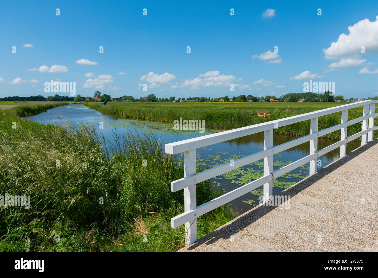 Bridge at Aarstwoud in Noord-Holland with water and Ditch. - Stock Image