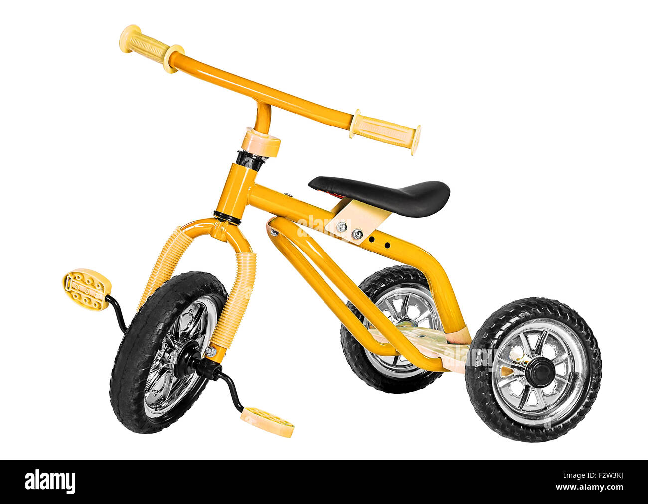 Kids yellow tricycle isolated on white background - Stock Image
