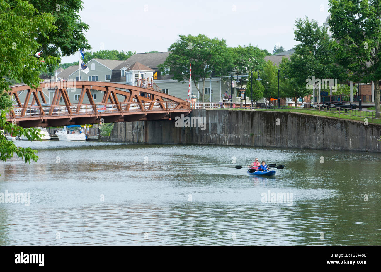 Rochester New York NY small town Fairport village and famous historical Erie Canal with boat and bridge on canal - Stock Image