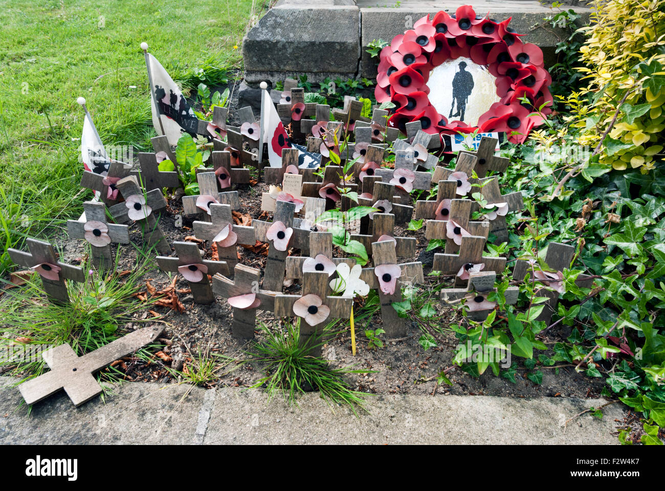 Remembrance at the base of the war memorial, Clitheroe Castle, Lancashire, UK - Stock Image