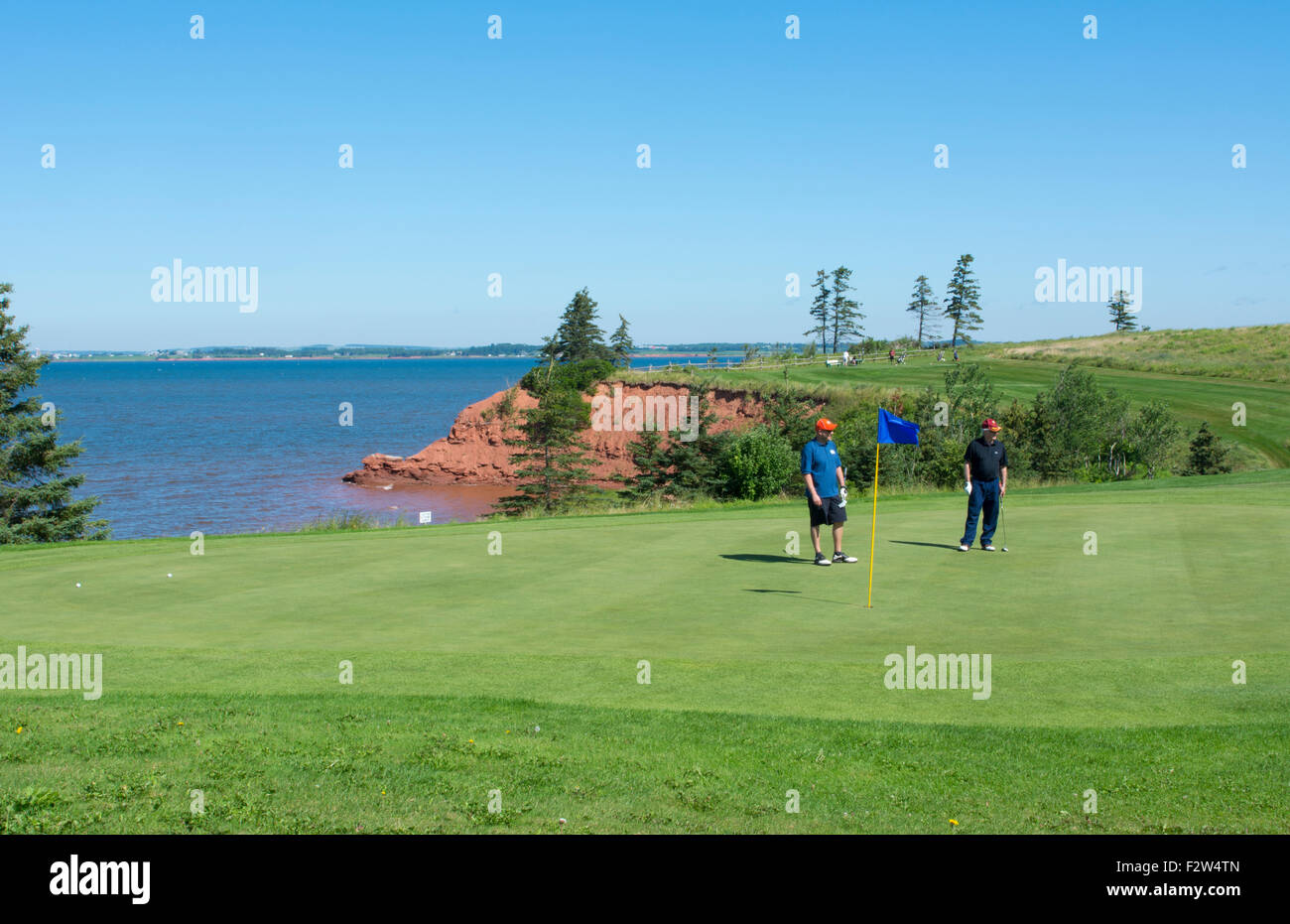 Canada Prince Edward Island, P.E.I. golfing at Belfast Highland Greens near ocean with cliff and golfers - Stock Image