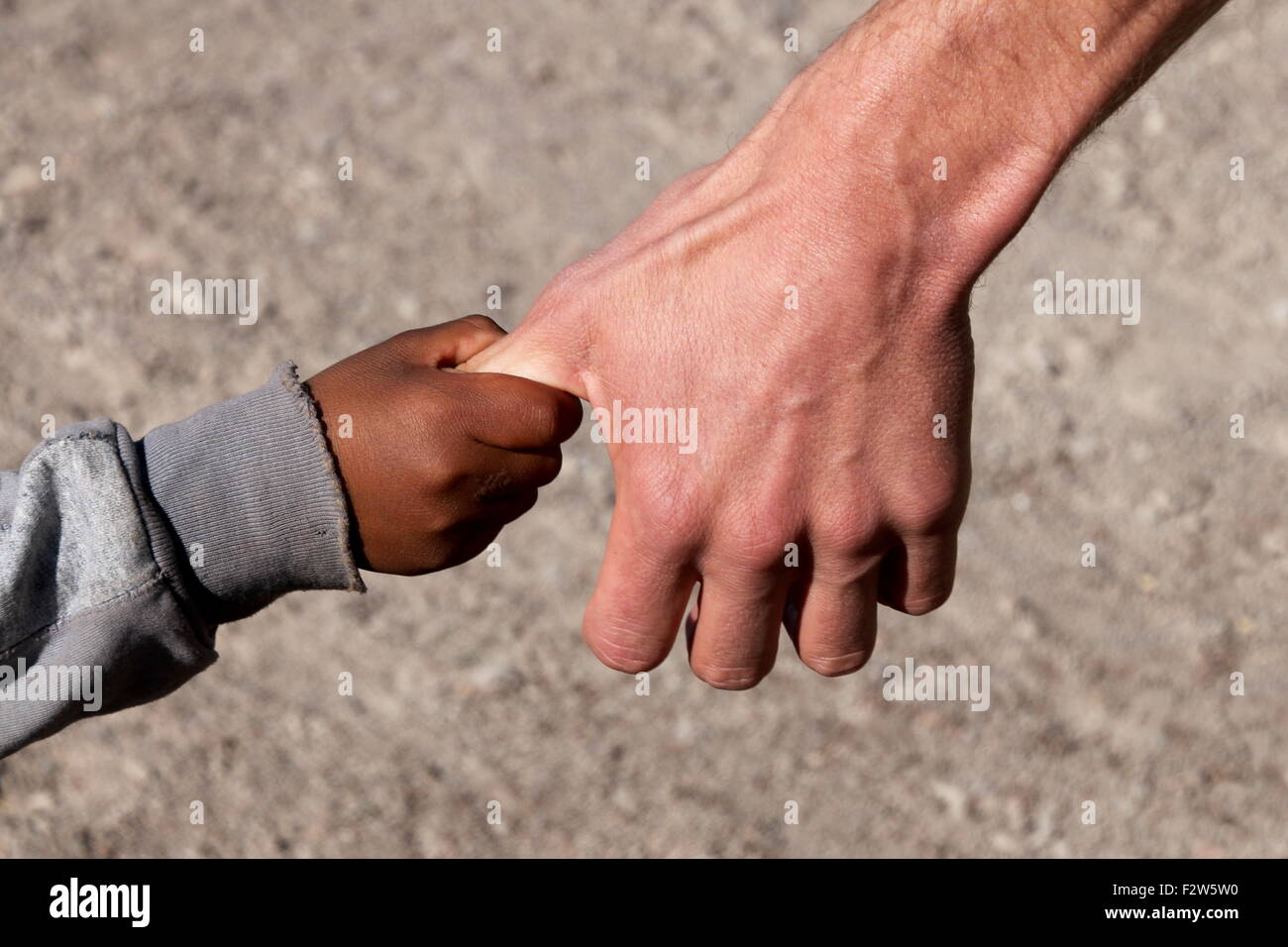A Refugee child on Hand of a Helper - Stock Image