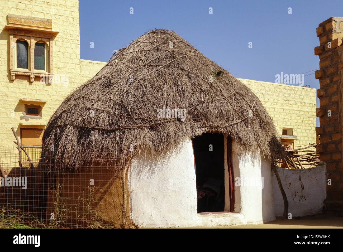 Mud hut with roof made of straws at badal house in khuri village jaisalmer