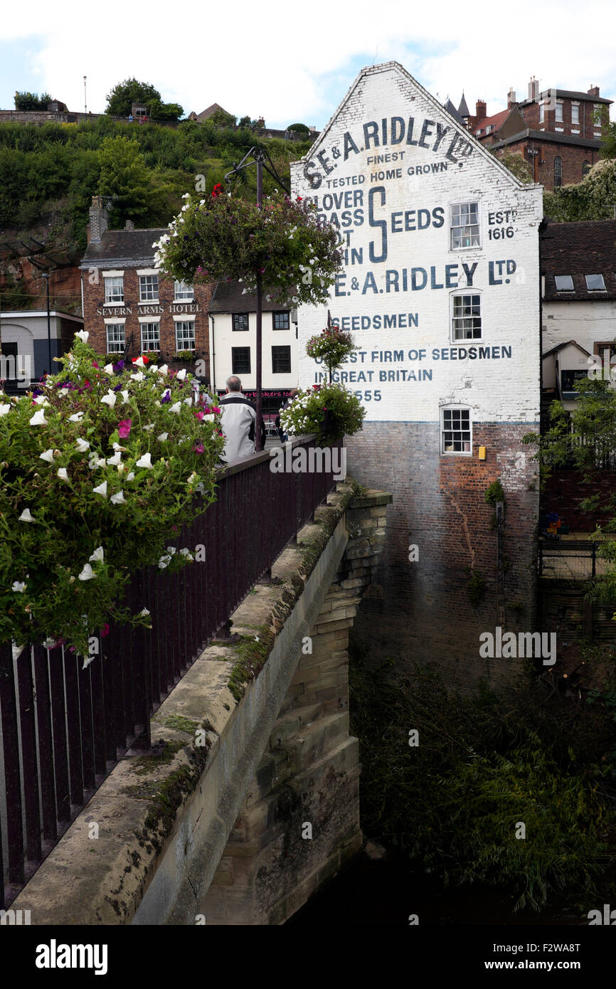 Old signage on the gable end of a building in Low Town, Bridgnorth, Shropshire, England, UK - Stock Image