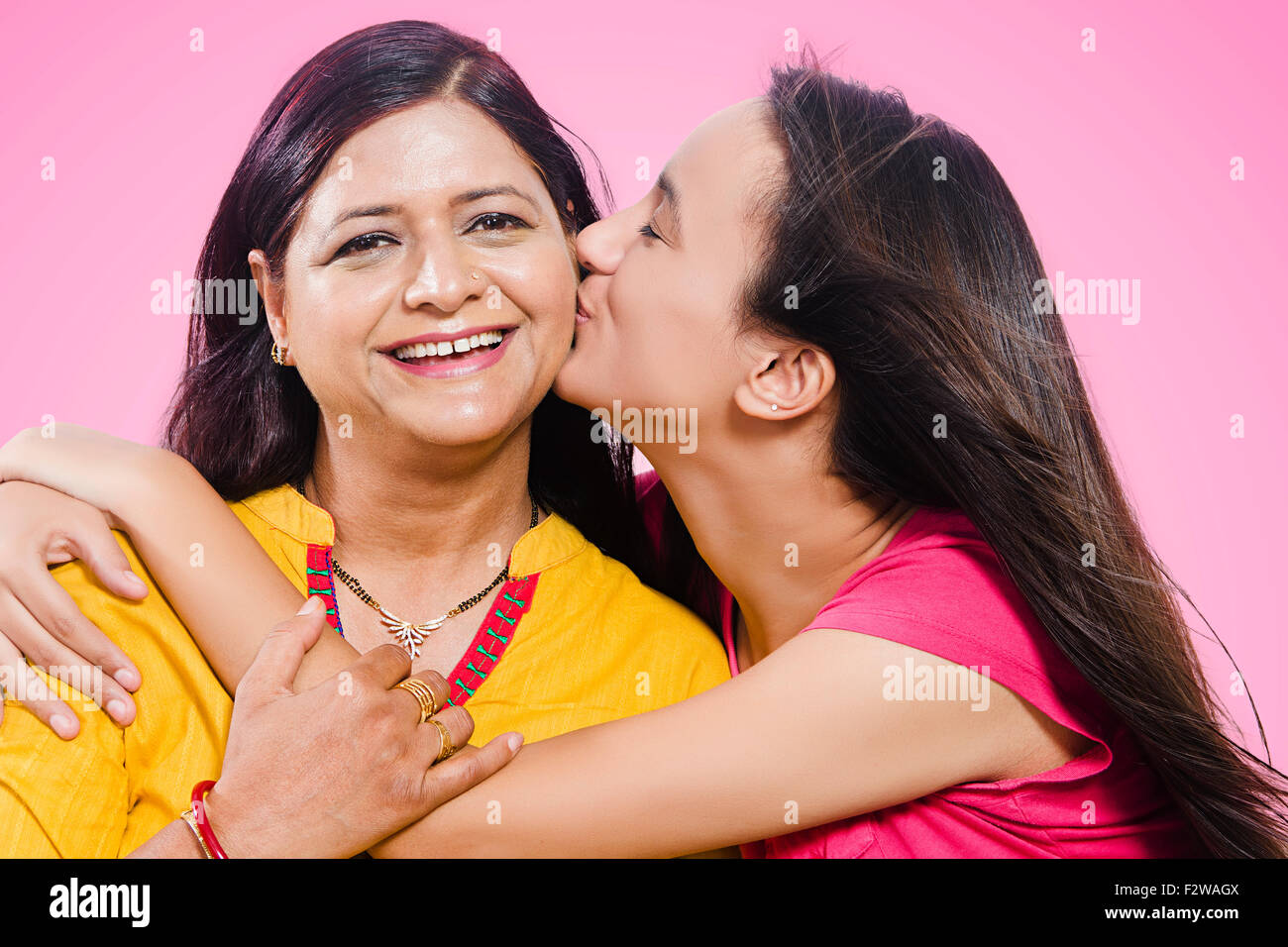 2 Indian Mother And Young Daughter Love Kissing Stock Photo