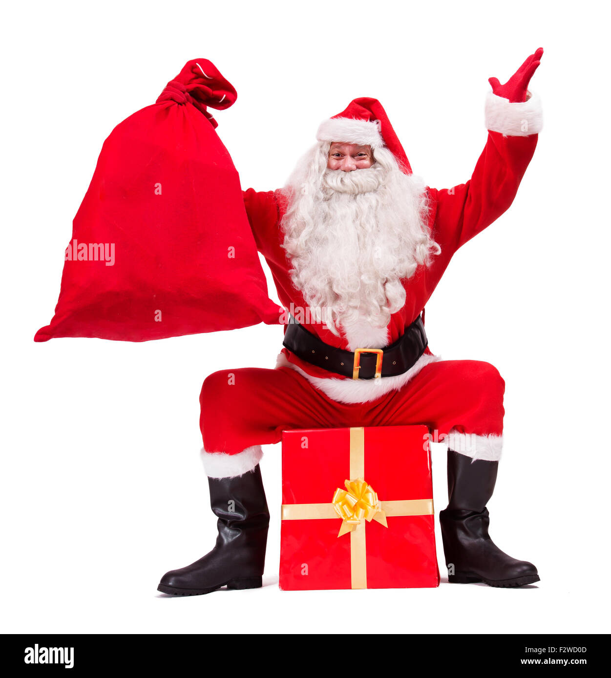 Santa Claus shows Christmas gift isolated on white background