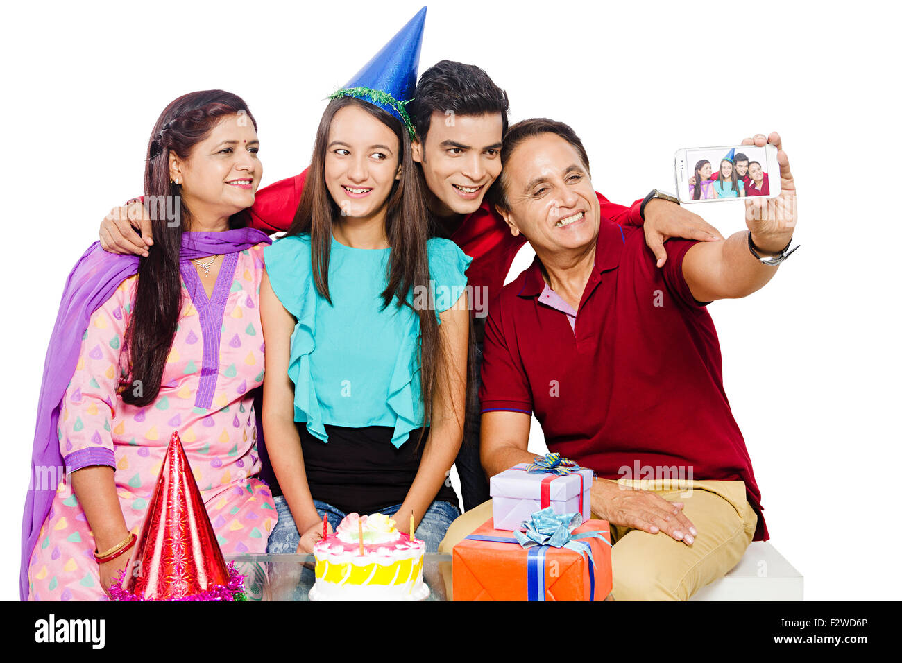 4 indian Presents young daughter and son Birthday Celebration Mobile Phone picture Clicking - Stock Image