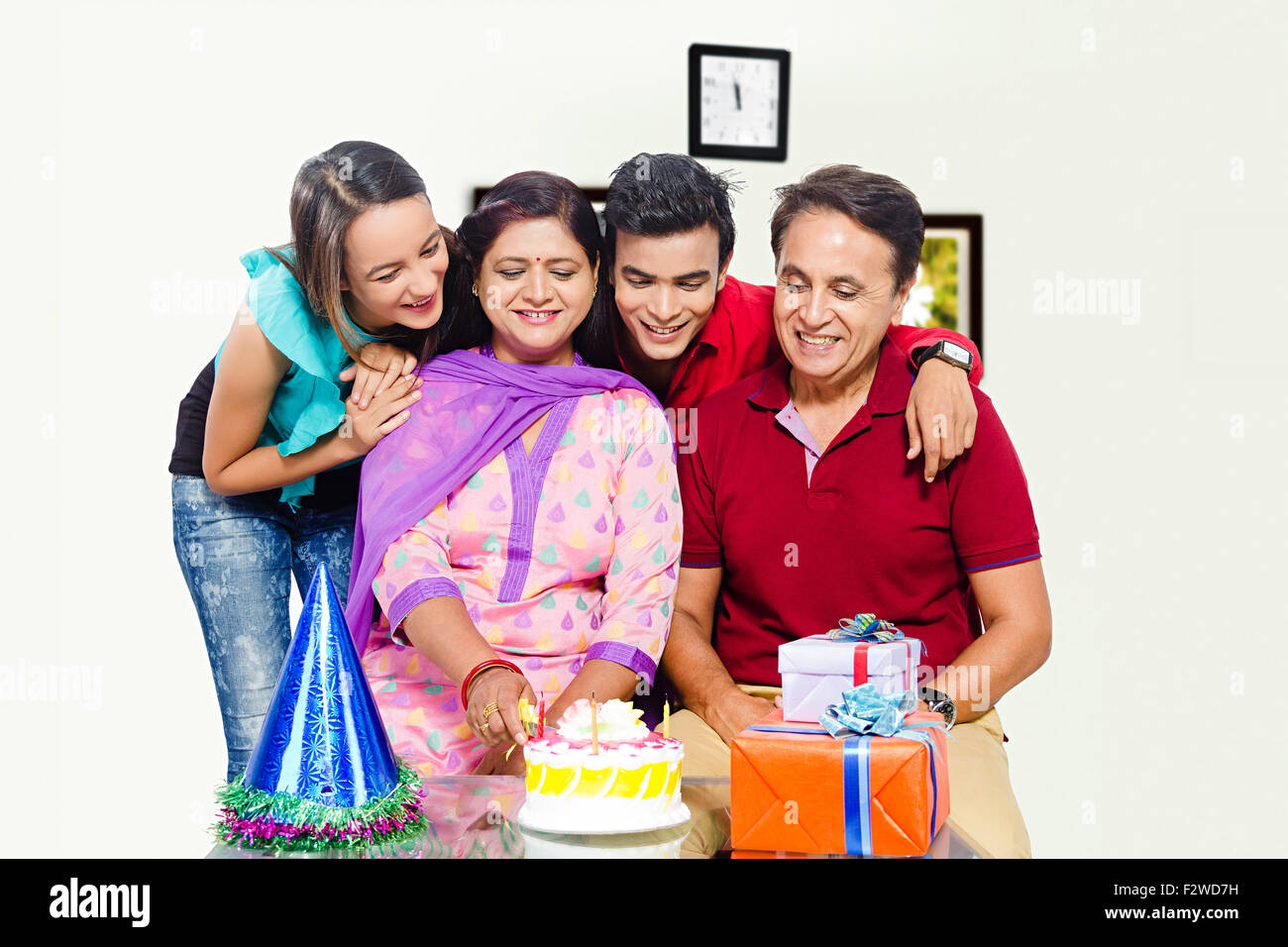 4 indian Presents young daughter and son Birthday Celebration - Stock Image