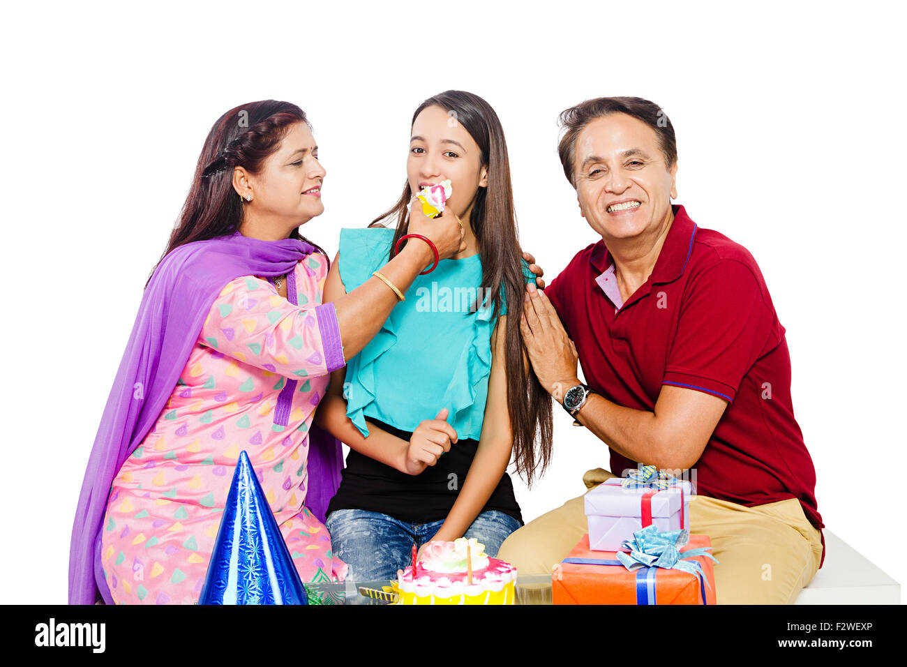 3 indian Presents young daughter Birthday Celebration - Stock Image
