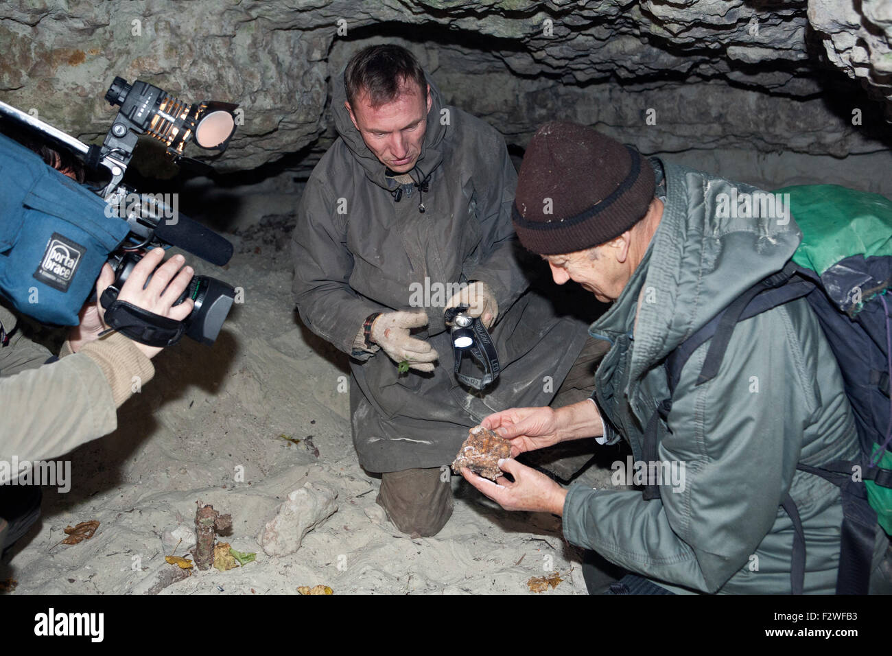 Sandstone cave explorers filmed in Abava river basin Kurzeme Latvia - Stock Image