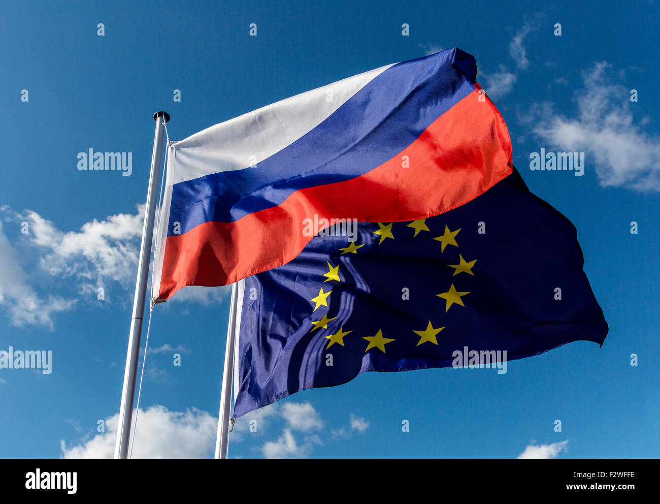 18.04.2015, Berlin, Berlin, Germany - Flag of Russian Federation and European Union flag blowing in the wind. - Stock Image