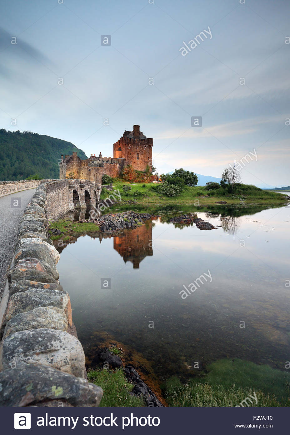 Eilean Donan castle reflecting on Loch Duich. - Stock Image