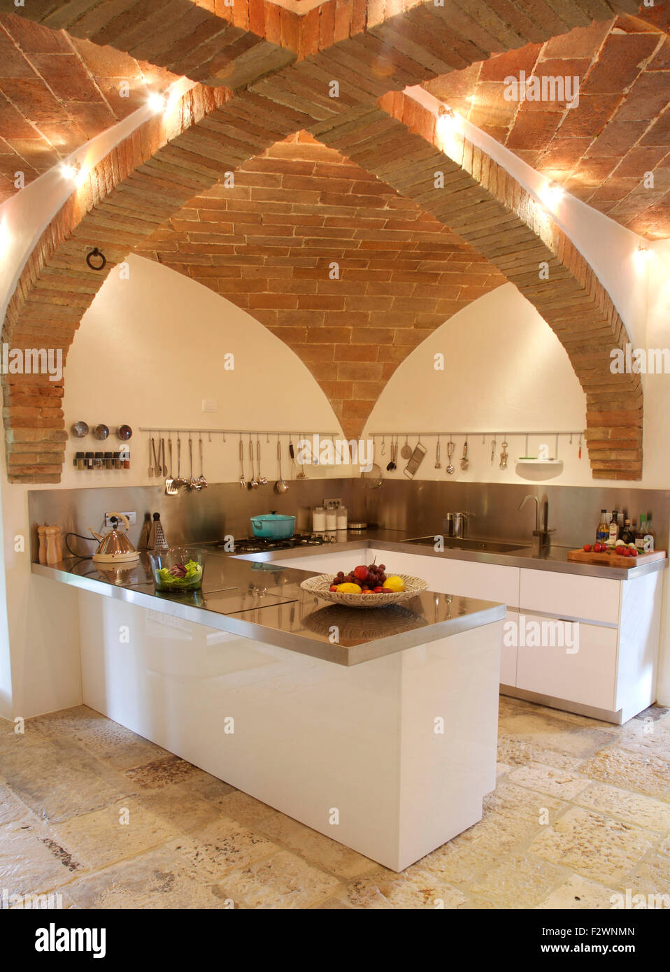 vaulted brick ceiling in contemporary italian kitchen with granite