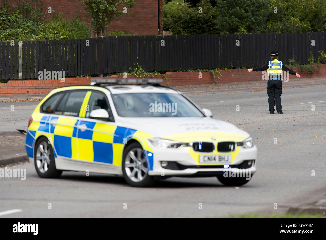 A police roadblock in place after a road traffic accident. - Stock Image