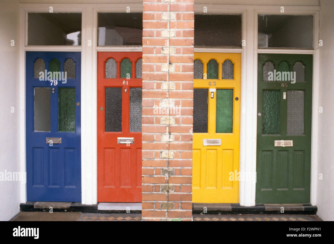 Row of colourfully painted front doors on Victorian terrace Stock ...
