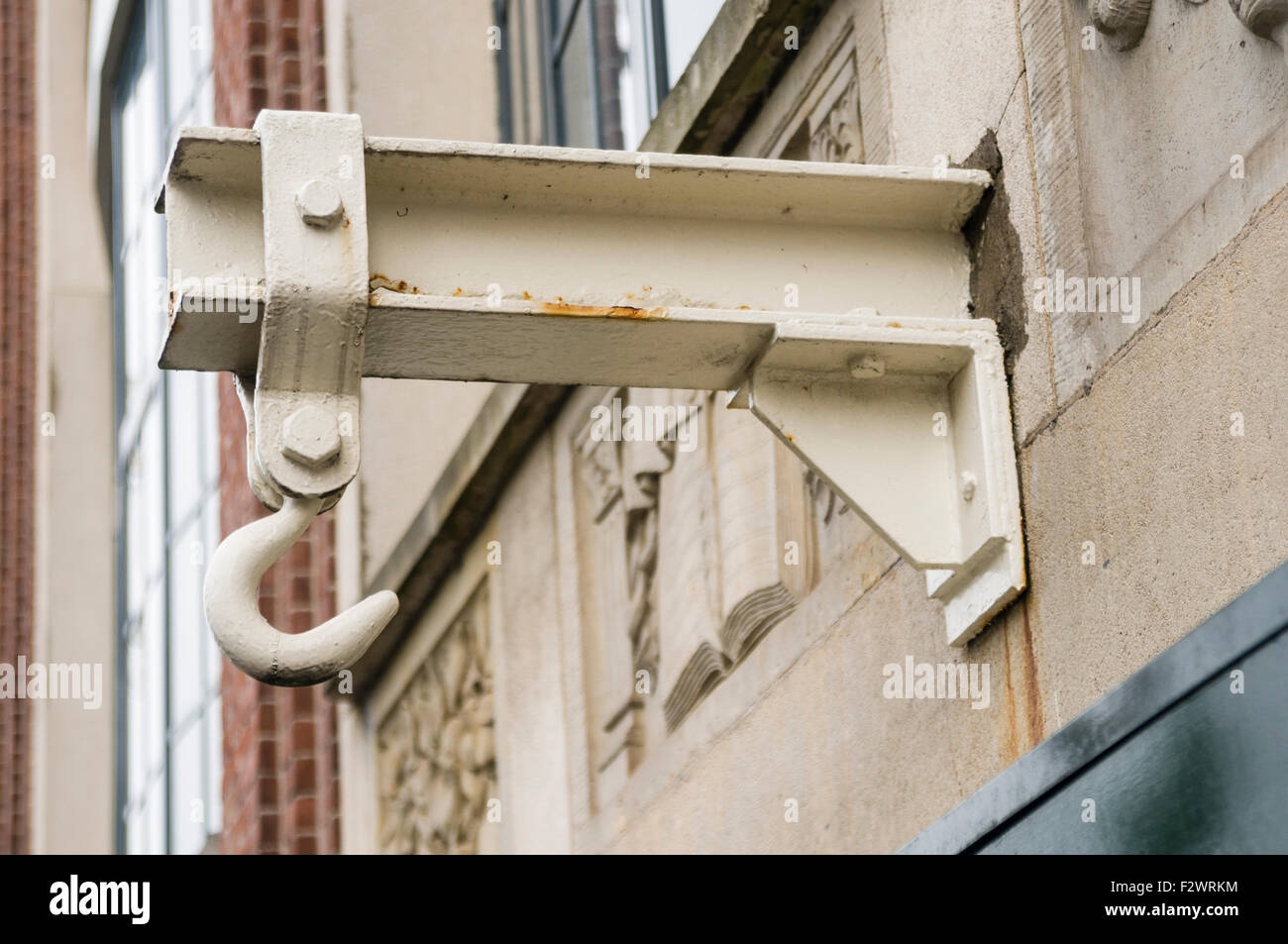 Hook at the top of a building in Amsterdam, used to get large and heavy items into the tall buildings. - Stock Image