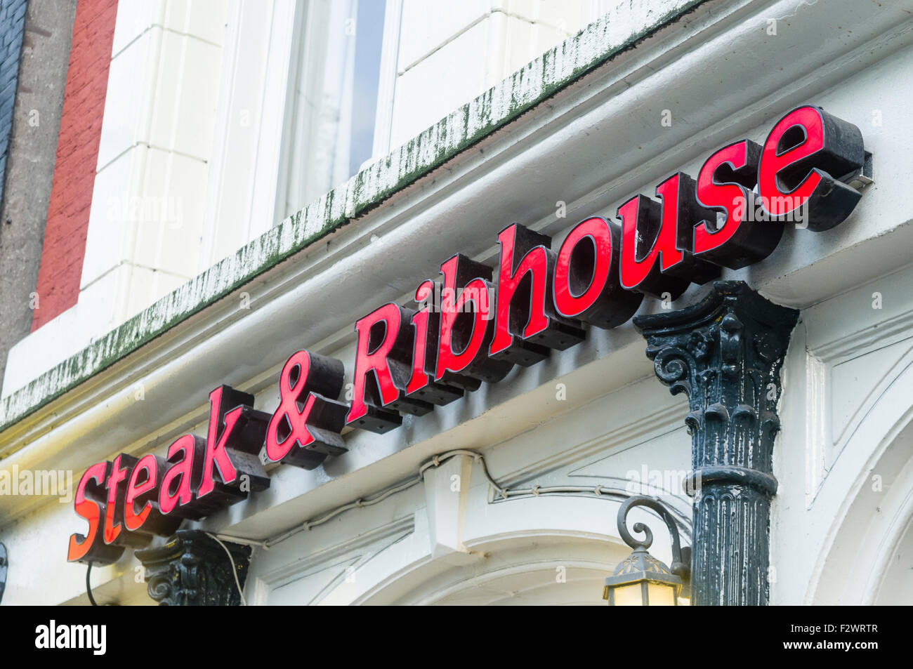 Sign outside a Steak and Ribhouse in Amsterdam, specialising in Argentinian and South American beef steak. - Stock Image
