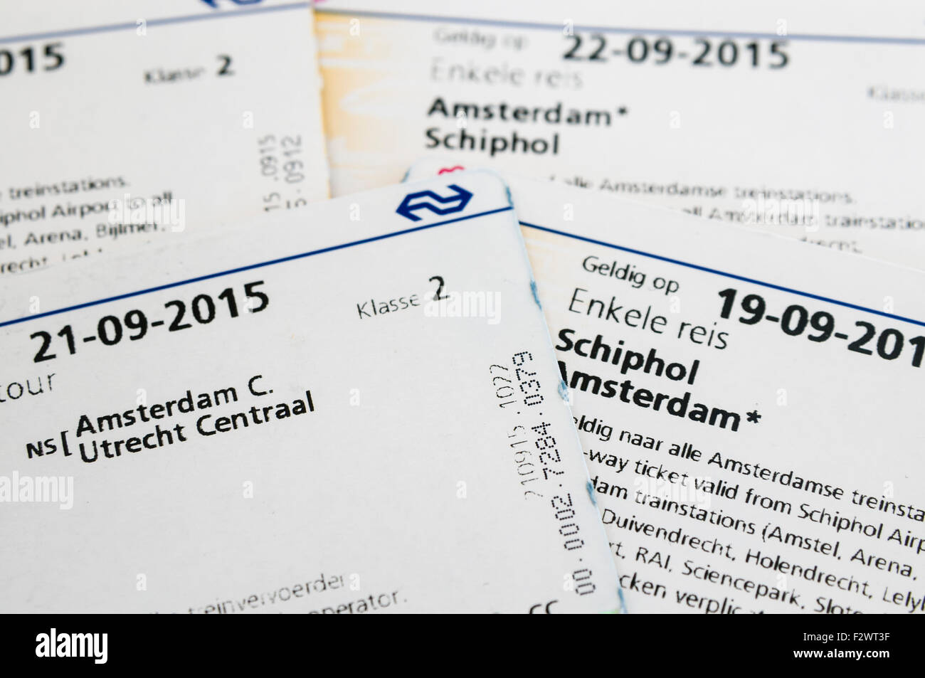 Return tickets for Amsterdam to Schiphol Airport and Utrecht Centraal on the Nederlandse Spoorwegen (NS) train. - Stock Image