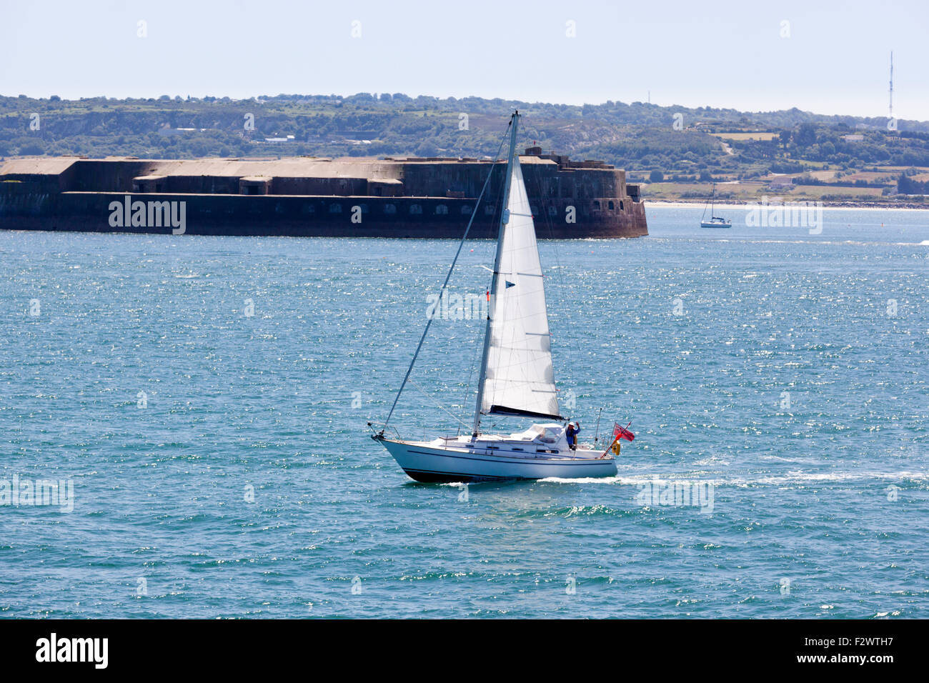 A sailing yacht entering the port at Cherbourg, Normandy, France Stock Photo