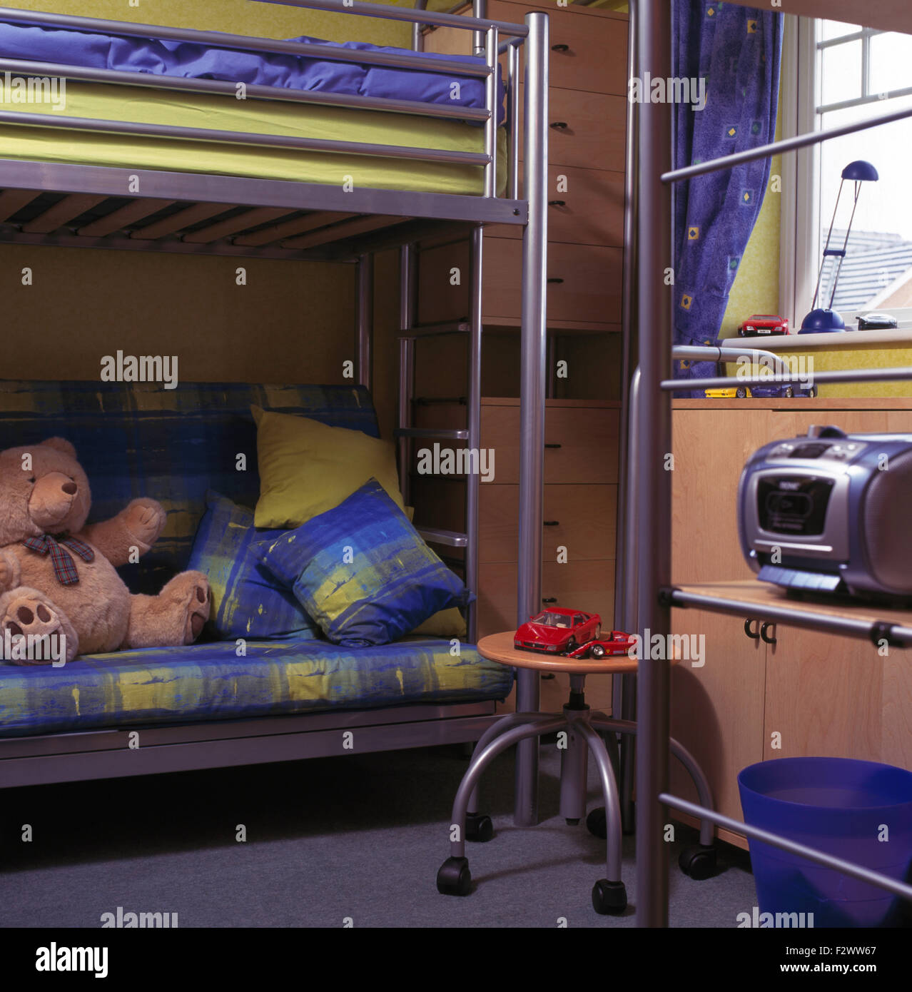 Picture of: Blue Green Cushions And Linen On Stainless Steel Bunk Beds In Stock Photo Alamy