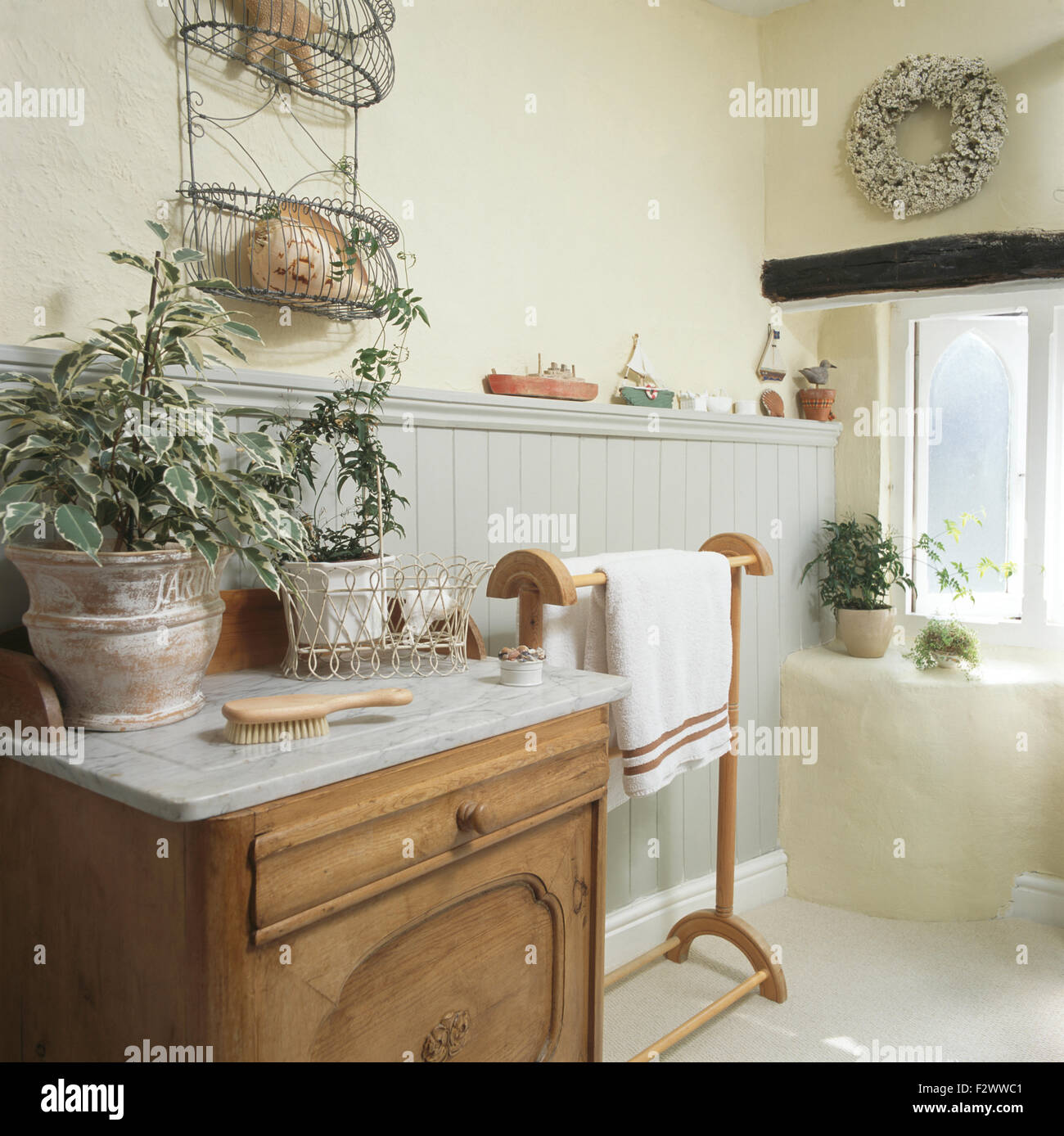 Green Plants In Pots On Marble Topped Washstand Cottage Bathroom With An Old Pine Towel Rail