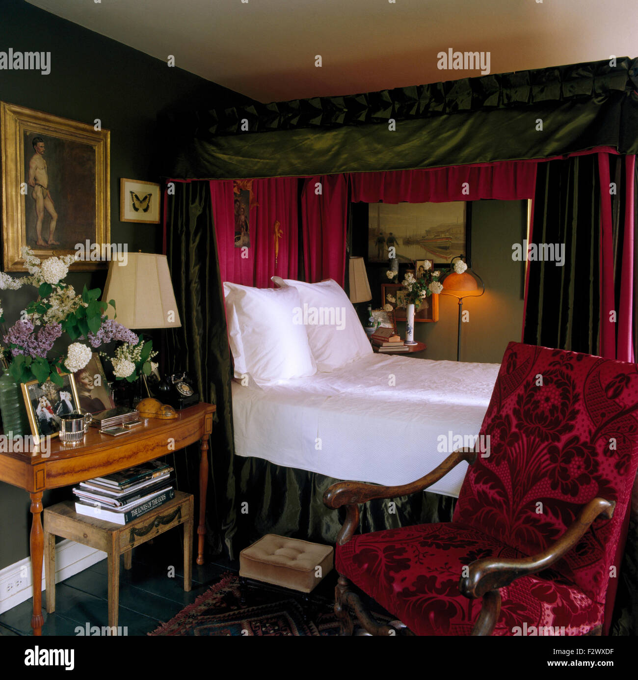 Wonderful Crisp White Linen And Pillows On Four Poster Bed With Green Silk Drapes  Lined With Red Silk In Opulent Eighties Bedroom