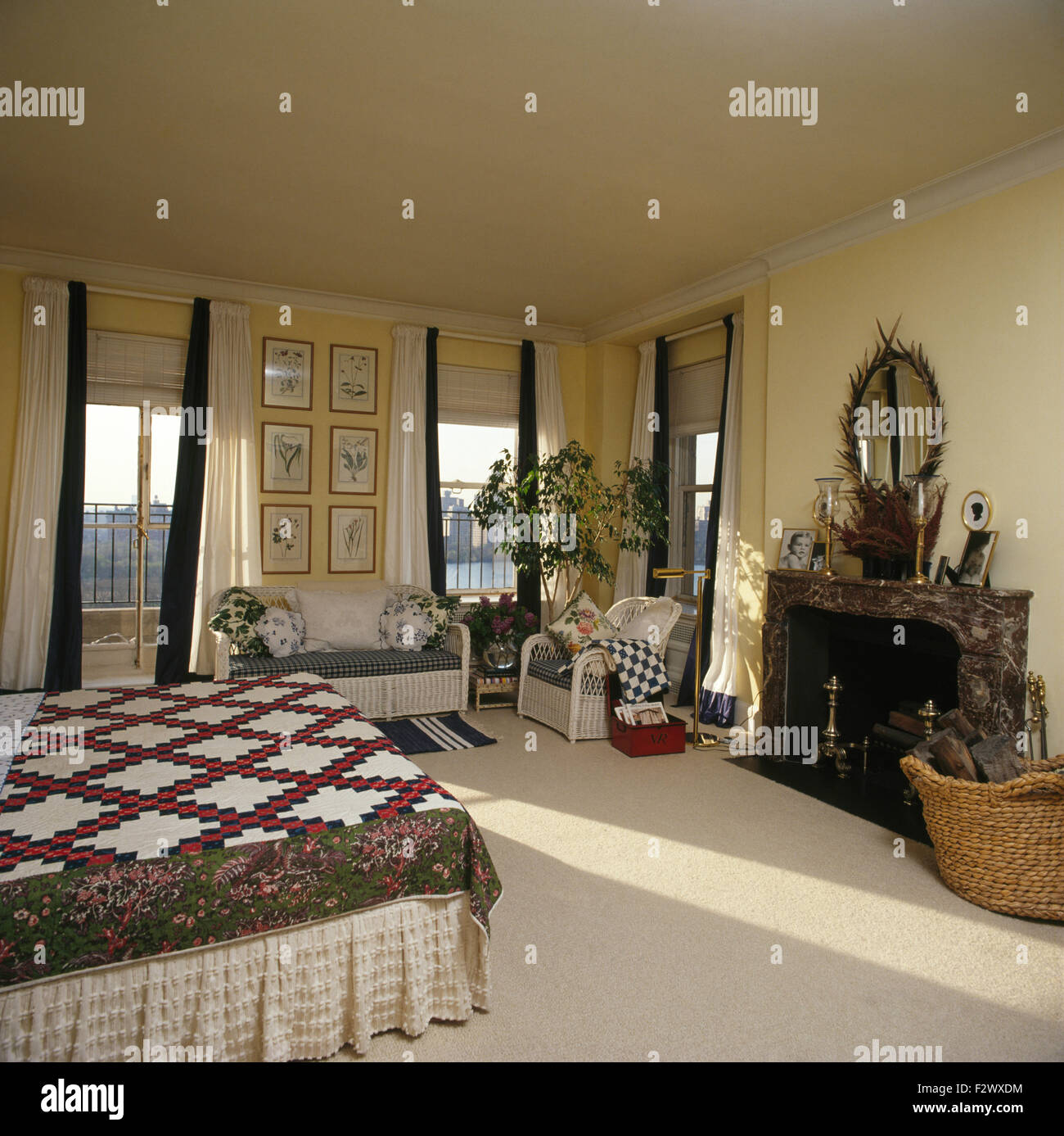 Black Marble Fireplace In City Bedroom With Patchwork Quilt On Bed Stock Photo Alamy