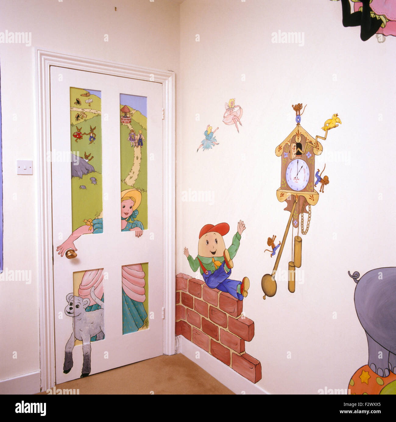 Nursery rhyme characters painted on door and wall in child's eighties bedroom - Stock Image